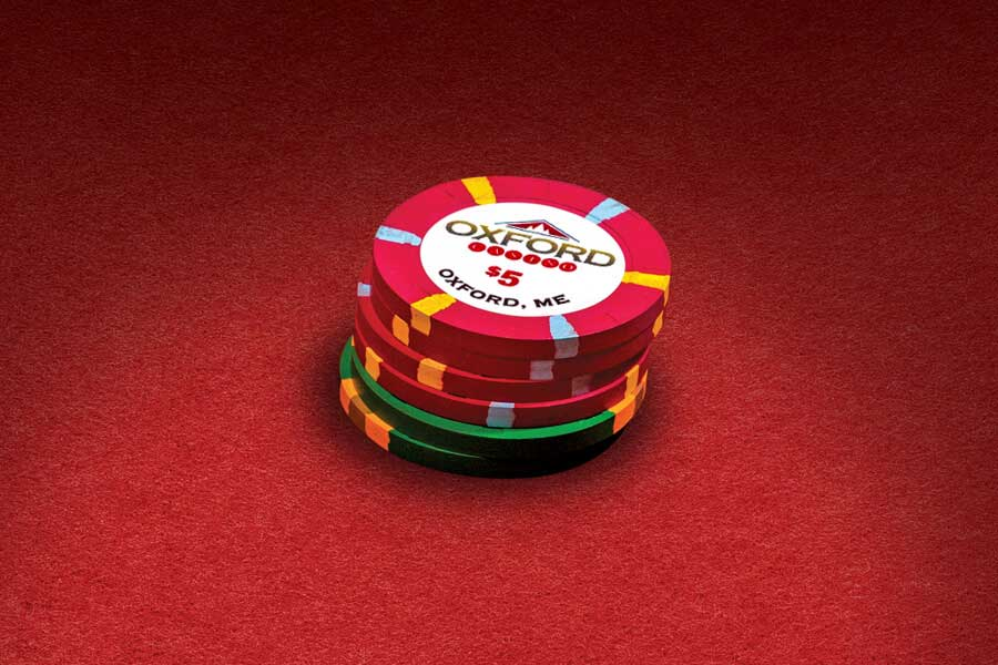 Stack of Red and Green Casino Chips Image