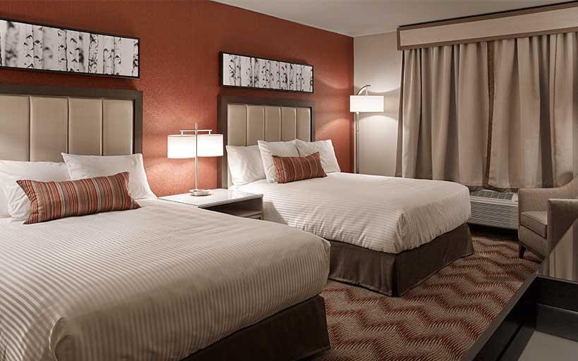 Double Queen Hotel Room Bed Area
